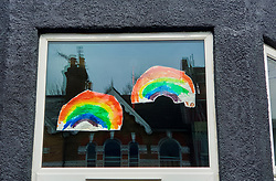 © Licensed to London News Pictures. 30/03/2020. London, UK. Hand painted pictures of colourful rainbows are displayed in a window of a house in north London. Rainbows are used as a symbol of peace and hope as coronavirus lockdown continues. Photo credit: Dinendra Haria/LNP