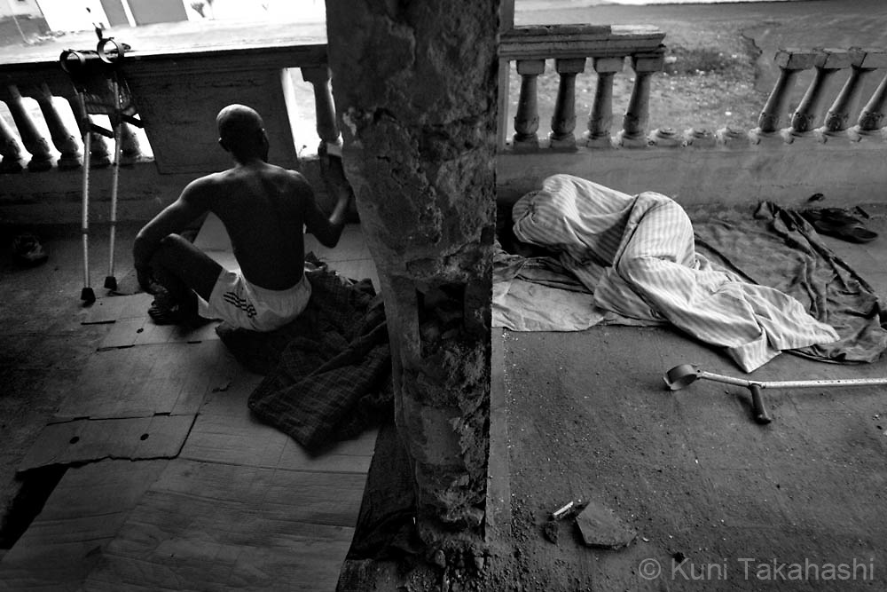 Amputee football players, Jimmy Harris, left, and Ruben Leaglor sleep at an abandoned building in Monrovia, Liberia, on May 8, 2008. The Liberian National team won the 2008 All Africa Amputee Cup of Nations, but the players - many of them ex-combatants and homeless - continue to struggle, receiving no support from the government or the amputee football league federation.