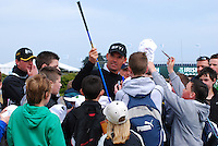 Padraig Harrington, professional golfer, Rep of Ireland, surrounded by young fans. 200905132430..Taken at the Irish Open Pro-Am Day, Wednesday 13 May 2009, at Baltray. Like most  participants he was dressed for warmth because of the chill easterly breeze coming off the Irish Sea.<br />