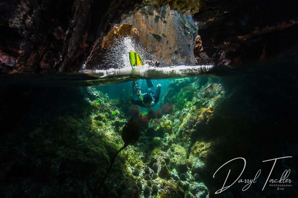 Snorkelling in a shallow water arch and caves at the Mokohinau Islands. This was one of the kids favourite snorkelling locations. New Zealand