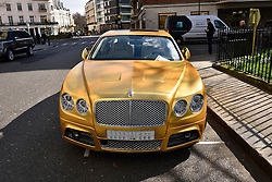 © Licensed to London News Pictures. 31/03/2016. London, UK. A fleet of supercars including a £350,000 Bentley covered in gold chrome wrap is parked in Knightsbridge, London on Wednesday, 31 March 2016. Cars are believed to be owned by Saudi billionaire Turki Bin Abdullah .Photo credit: Ray Tang/LNP