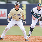 UNCW's Corey Dick covers first base as Wake Forest's Bruce Steel leads off Sunday February 22, 2015 during the Hughes Brothers Challenge at Brooks Field. (Jason A. Frizzelle)