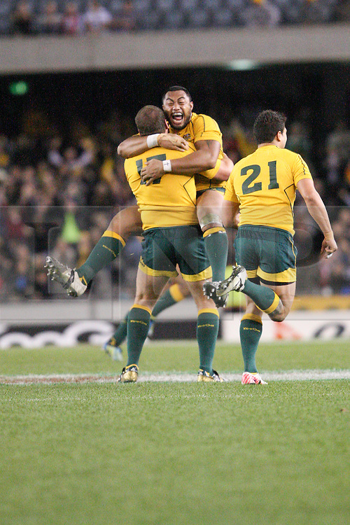 © Licensed to London News Pictures. 16/06/2012. Etihad Stadium, Melbourne Australia. Australian players celebrate after their after the siren win during the 2nd Rugby Test between Australia Wallabies Vs Wales . Photo credit : Asanka Brendon Ratnayake/LNP