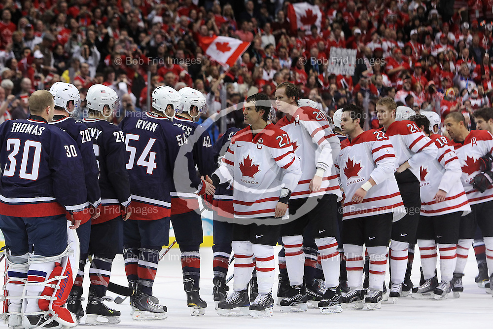 28 February 2010: Team shakes hands at the end of the Gold medal Hockey Final between the United States and Canada during the Vancouver 2010 Winter Olympics  in Vancouver,  British Columbia, Canada..