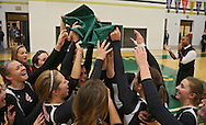 Springville celebrates with their State Tournament Qualifier banner after the Class 1A regional final match at Iowa City West High School in Iowa City on Wednesday, November 6, 2013. Springville defeated New London 3-2.
