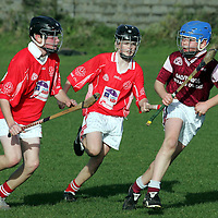 051105<br /> Doora Barefield's Patrick McInerney (right) under pressure from Eire Ogs Alan Barrett (far left) and Willie Twomey during their U13 Semi Final at Eire Og on Saturday  Morning.Pic Arthur Ellis/Press 22.