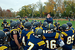 Penn Charter head coach Tommy Coyle addresses his team after the loss.
