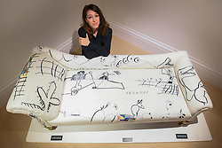 "© Licensed to London News Pictures. 26/02/2020. LONDON, UK. Artist Annie Morris poses with her work, a decorated antique chaise longue, called ""Hope From a Thin Line"", 2019 (Starting price GBP8,000).  Preview of ""Human Touch"", an exhibition of one-of-a-kind artworks by international contemporary artists in collaborations with stitchers in British prisons.  In association with the charity Fine Cell Work, the artworks are on show at Sotheby's New Bond Street 26 February to 3 March 2020.  Photo credit: Stephen Chung/LNP"