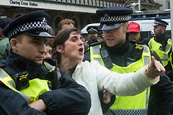 London, April 1st 2017. A woman hurls abuse at anti-fascist counter demonstrators as protesters from nationalist and anti-Islamic group Britain First demonstrate in London following the Westminster terror attack of March 22nd.