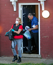© Licensed to London News Pictures. 19/08/2018<br /> New Eltham, UK. Police remove items from a property on Adderley Gardens, believed to be the home of attacker Joe Xuereb. Police are currently looking for 27 year old Joe Xuereb following a Hammer attack on two women in New Eltham, south east London.  <br /> Photo credit: Grant Falvey/LNP