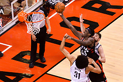 February 11, 2019 - Toronto, Ontario, Canada - Jarrett Allen #31 of the Brooklyn Nets grabs a hand of Pascal Siakam #43 of the Toronto Raptors during his dunk over during the Toronto Raptors vs Brooklyn Nets NBA regular season game at Scotiabank Arena on February 11, 2019, in Toronto, Canada (Toronto Raptors win 127-125) (Credit Image: © Anatoliy Cherkasov/NurPhoto via ZUMA Press)