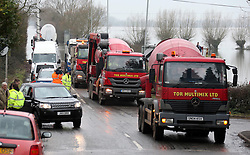© London News Pictures. 31/01/2014. Burrowbridge, UK. Cement mixers, which are used to build flood defences,  arriving in the village of Burrowbridge, Somerset on the Somerset levels. The area has been hit severely by recent flooding which is forecast to get worse over the weekend . Photo credit: Jason Bryant/LNP