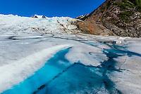 Azure blue meltwater pools, Mendenhall Glacier, Juneau, Alaska USA.