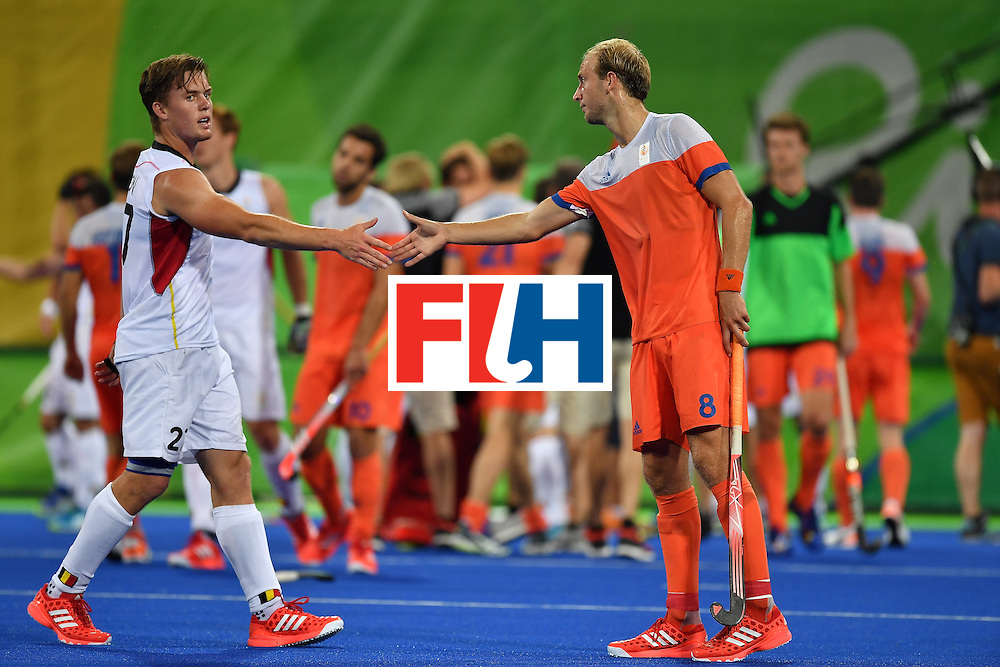 RIO DE JANEIRO, BRAZIL - AUGUST 16:  Tom Boon of Belgium (L) shakes hans with Billy Bakker of the Netherlands (R) after winning the Men's semifinal hockey match Belgium vs Netherlands at the Olympic Hockey centre on August 16, 2016 in Rio de Janeiro, Brazil.  (Photo by Pascal Le Segretain/Getty Images)