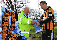 A Hull city fan buying a half &amp; half scarf before KO during the Barclays Premier League match at the KC Stadium, Kingston upon Hull<br /> Picture by Richard Gould/Focus Images Ltd +44 7855 403186<br /> 15/03/2014