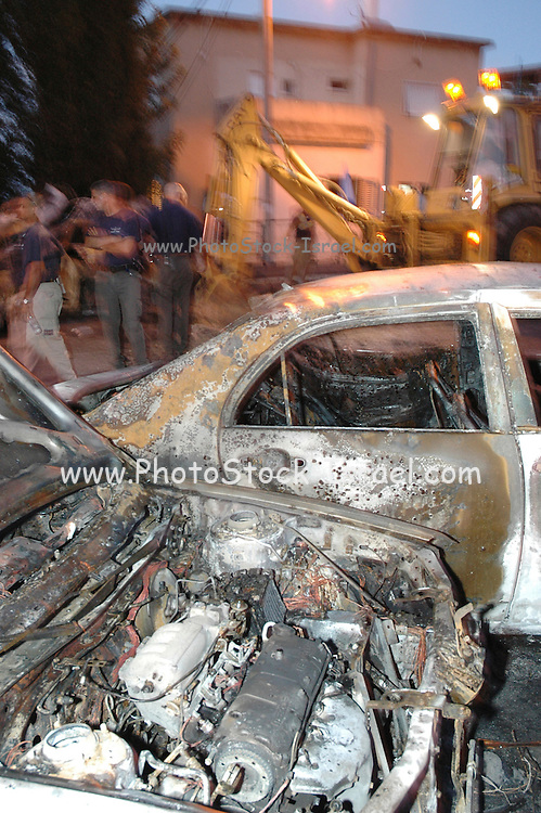 Israel, Haifa, Cars hit by a missile Katyusha rocket during the Second Lebanon war. August 13 2006