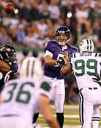 Sept 13, 2011; East Rutherford, NJ, USA; Baltimore Ravens quarterback Joe Flacco (5) passes the ball while under pressure from New York Jets linebacker Jason Taylor (99) during the first half at the New Meadowlands Stadium.