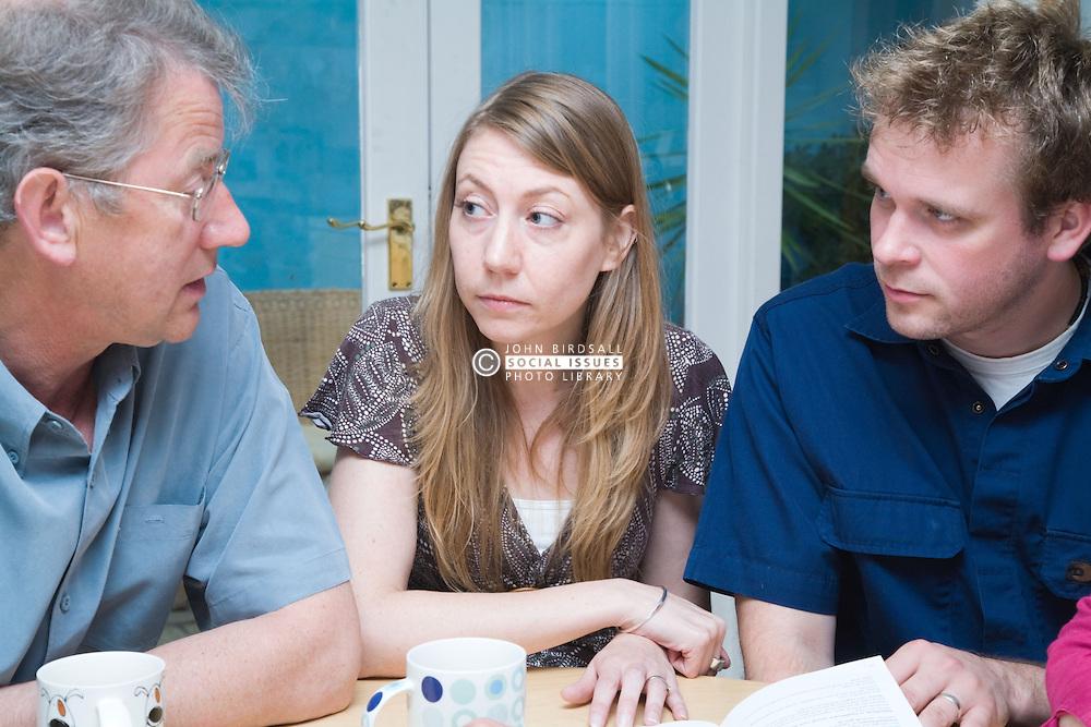 Adults chatting over a mug of tea,