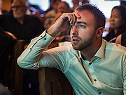 09 NOVEMBER 2016 - BANGKOK, THAILAND: A person watching US election results in Bangkok reacts to news that Donald J. Trump had taken the lead in the Electoral College vote. Democrats Abroad Thailand met at the Roadhouse Barbecue, an American restaurant in Bangkok to watch election results come in. It was a somber election watch party as what was expected to be a Clinton victory turned into a Trump win.      PHOTO BY JACK KURTZ