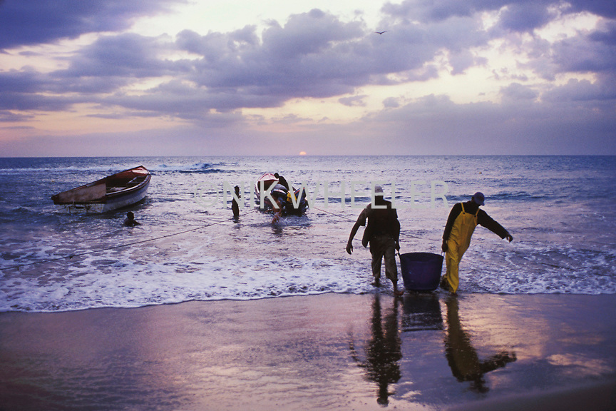 Fisherman Bring Fish Catch off Boats at Dawn from Calabash Bay on Treasure Beach in Jamaica