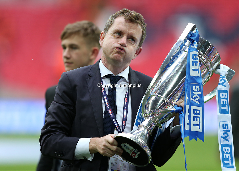May 29th 2017, Wembley Stadium, London, England; EFL Championship playoff final, Huddersfield Town versus Reading; Huddersfield Town chairman Dean Hoyle holding the EFL Championship playoff final towards the Huddersfield Town fans with a sigh of relief