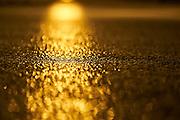 Sunset Bokeh reflections on a flat sea at Gerroa, NSW, Australia