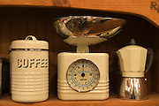 A display of old style scale, coffee jar and coffee maker