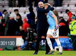 Manchester City Boss Pep Guardiola celebrates with  Oleksandr Zinchenko at full time during the Premier League match at The Vitality Stadium, Bournemouth.