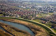 Nederland, Gelderland, Culemborg, 11-02-2008; Goilbedingerwaard, uiterwaard van de Lek ten Weten van Culemborg, met de woonwijk Molenzicht veilig achter de rivierdijk; de aangeslibte klei van de uiterwaard  (voorgrond) is gedeeltelijk weggegraven om ruimte te maken voor de rivier, waterberging bij hoog water; ..luchtfoto (toeslag); aerial photo (additional fee required); .foto Siebe Swart / photo Siebe Swart