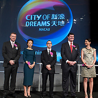 MACAU, CHINA - JUNE 01: Businessman James Packer (2ndR) wife Erica Baxter (R), CEO of Melco Entertainment Lawrence Ho (C) wife Sharen Ho and President of 'City of Dreams' Greg Hawkins (L) pose during the opening of Packer and Ho's 'City of Dreams' casino on June 1, 2009 in Cotai, Macau. The new 420,000 square foot casino, built on marshland 9km from Macao's traditional casino district but over the road from the world's largest casino 'Sands Venetian Macao', hopes to lure customers to the new casino area. 'City of Dreams' will offer over 500 gambling tables alongside its 3 hotels, a shopping mall and digital fish which swim in an electronic aquarium know as 'The Bubble'.  Photo by Victor Fraile / studioEAST