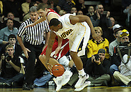 21 JANUARY 2009: Wisconsin's Jon Leuer (30) and Iowa's David Palmer (2) battle for a lose ball during the first half of an NCAA college basketball game Wednesday, Jan. 21, 2009, at Carver-Hawkeye Arena in Iowa City, Iowa. Iowa defeated Wisconsin 73-69 in overtime.