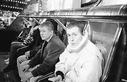 Two Boys on Fairground Ride, UK. 1980s.