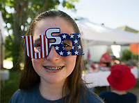 Danika Burke sporting a pair of USA glasses at the Gilmanton 4th of July parade on Wednesday morning.  (Karen Bobotas/for the Laconia Daily Sun)