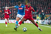 Liverpool midfielder Georginio Wijnaldum (5) and Napoli defender Giovanni Di Lorenzo (22) in action during the Champions League match between Liverpool and Napoli at Anfield, Liverpool, England on 27 November 2019.