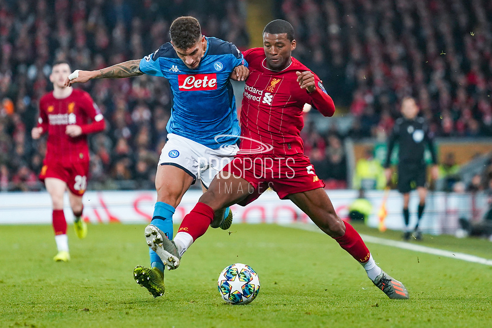 Liverpool midfielder Georginio Wijnaldum (5) and Napoli defender Giovanni Di Lorenzo (22) in action during the Champions League match between Liverpool and Napoli at Anfield, Liverpool, England on 27 November 2019.