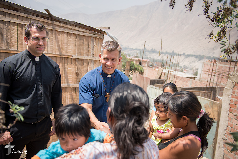 The Rev. Mark Eisold, LCMS career missionary to Peru, talks to residents in the landslide affected area of Huayaringa, Peru, on Tuesday, April 7, 2015. Eisold is joined by the Rev. Ross Johnson, LCMS director of Disaster Response. LCMS Communications/Erik M. Lunsford
