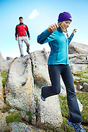 A man and woman explore the rocky tundra on Mt. Evans in the Colorado rockies.