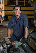 Houston ISD mechanic David Jane poses for a photograph at the Northwest bus barn, July 16, 2014.