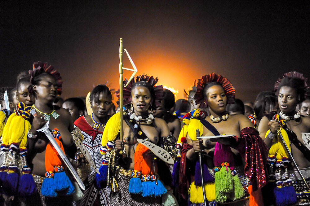 Ludzidzini, Swaziland, Africa - Annual Umhlanga, or reed dance ceremony, in which up to 100,000 young Swazi women gather to celebrate their virginity and honor the queen mother during the 8 day long event.<br /> Princesses leading the dance