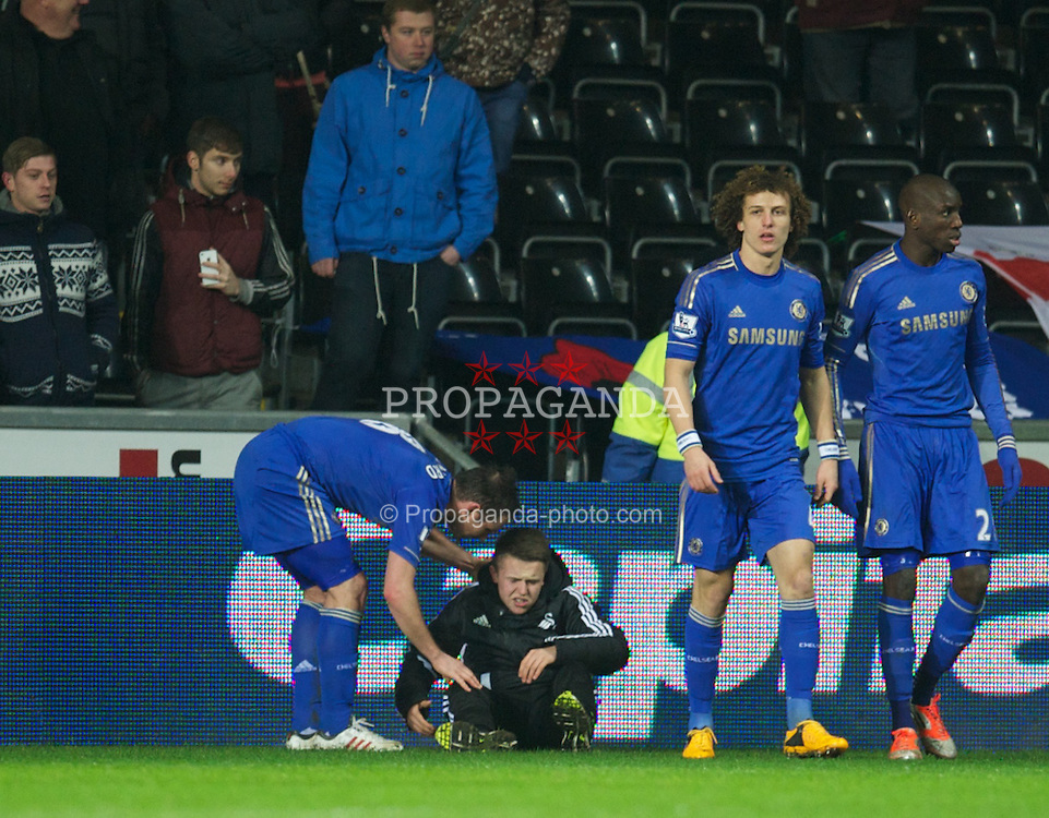 SWANSEA, WALES - Wednesday, January 23, 2013: Chelsea's Frank Lampard checks on injured Swansea City ball boy Charlie Morgan after being kicked by Chelsea's Eden Hazard during the Football League Cup Semi-Final 2nd Leg match at the Liberty Stadium. (Pic by David Rawcliffe/Propaganda)