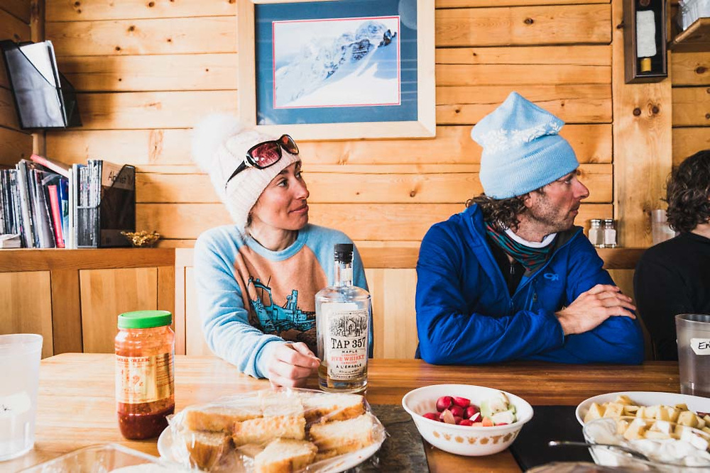 Brunch of champions. Emily Bodner drinks her second breakfast at the Burnie Glacier Chalet, Howson Range, BC.