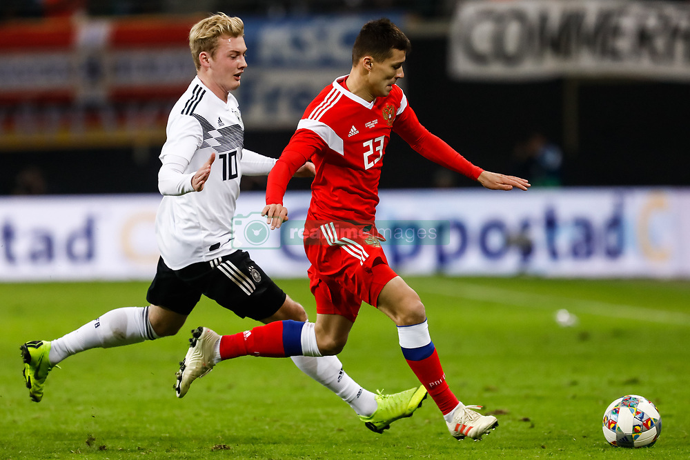 November 16, 2018 - Leipzig, Germany - Julian Brandt (L) of Germany and Dmitri Poloz of Russia vie for the ball during the international friendly match between Germany and Russia on November 15, 2018 at Red Bull Arena in Leipzig, Germany. (Credit Image: © Mike Kireev/NurPhoto via ZUMA Press)