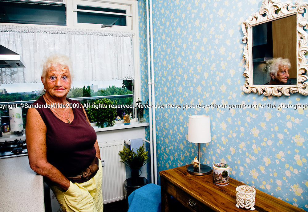 Woman in her appartment in Rotterdam, photographed for a magezine called Renoview.