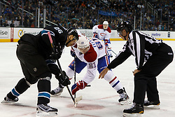 Dec 1, 2011; San Jose, CA, USA; NHL linesman Brad Lazarowich (86) drops the puck to Montreal Canadiens center Lars Eller (81) and San Jose Sharks center Michal Handzus (26) on a face off during the second period at HP Pavilion.  Mandatory Credit: Jason O. Watson-US PRESSWIRE