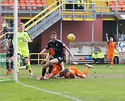14th April 2018, Tannadice Park, Dundee, Scotland; Scottish Championship football, Dundee United versus Falkirk; Reghan Tumilty of Falkirk clears from Thomas Mikkelsen and Scott McDonald of Dundee United