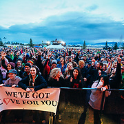 Micahel Franti and Spearhead perform to a packed crowd in Teton Village, Wyoming. Concert crowd arms in the air.