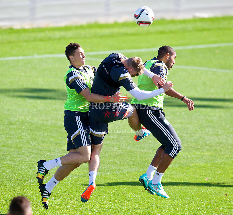 NEWPORT, WALES - Tuesday, October 7, 2014: Wales' James Chester, Simon Church and captain Ashley Williams during training at Dragon Park National Football Development Centre ahead of the UEFA Euro 2016 qualifying match against Bosnia and Herzegovina. (Pic by David Rawcliffe/Propaganda)