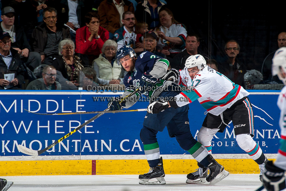 KELOWNA, CANADA - APRIL 22: Rodney Southam #17 of Kelowna Rockets checks Jerret Smith #2 of Seattle Thunderbirds on April 22, 2016 at Prospera Place in Kelowna, British Columbia, Canada.  (Photo by Marissa Baecker/Shoot the Breeze)  *** Local Caption *** Jerret Smith; Rodney Southam;