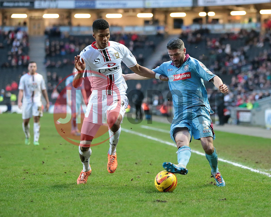 Tranmere Rovers' Ryan Lowe is challenged by Milton Keynes Dons' Jordan Spence - Photo mandatory by-line: Nigel Pitts-Drake/JMP - Tel: Mobile: 07966 386802 01/02/2014 - SPORT - FOOTBALL - Stadium MK - Milton Keynes - MK Dons v Tranmere Rovers - Sky Bet League One
