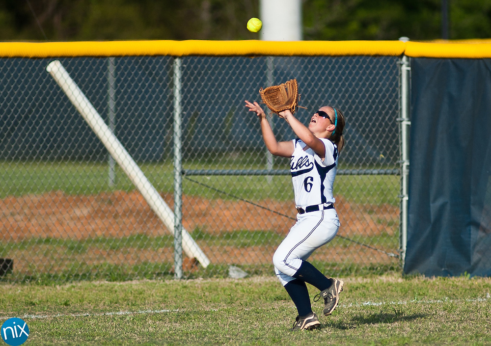Hickory Ridge's Mary Hart catches a fly ball against Concord in South Piedmont Conference softball action Tuesday afternoon in Harrisburg. Hickory Ridge won the game 7-1.  (Photo by James Nix)